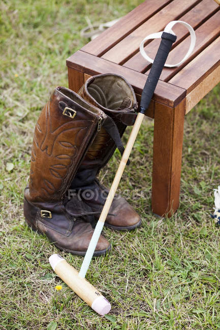 Polo mallet and boots — Stock Photo