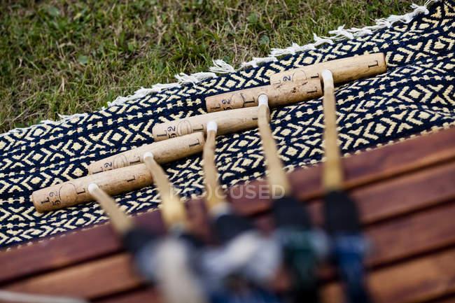 Polo mallets on blanket — Stock Photo