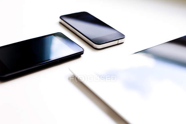 Smart phones and digital tablet — Stock Photo