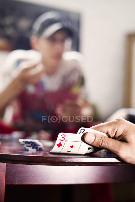 Hand opening playing cards — Stock Photo