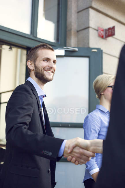 Happy businessman shaking hand — Stock Photo