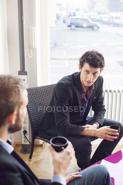 Businessmen having coffee — Stock Photo