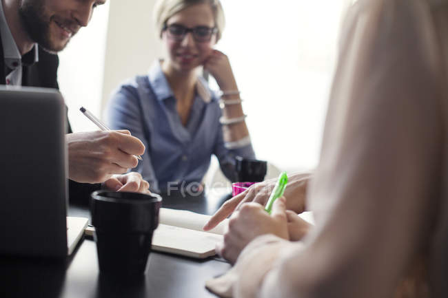 Midsection of young business people — Stock Photo