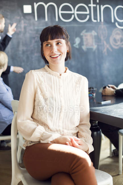 Thoughtful businesswoman sitting in office — Stock Photo