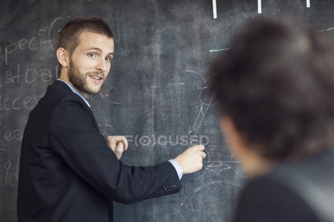 Confident businessman giving presentation — Stock Photo
