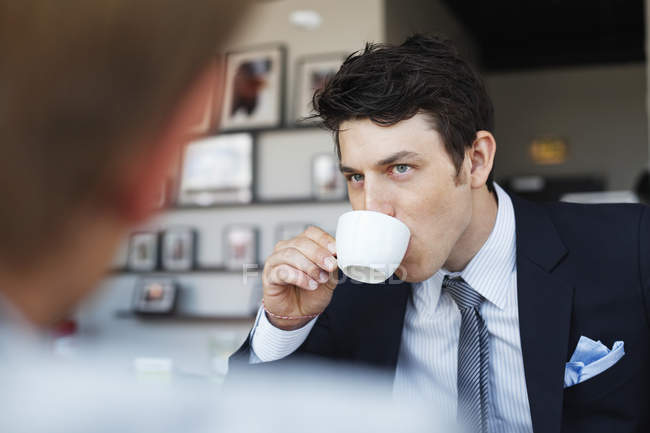 Handsome businessman having coffee — Stock Photo