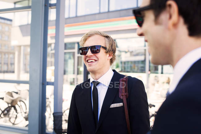 Cheerful businessmen smiling — Stock Photo