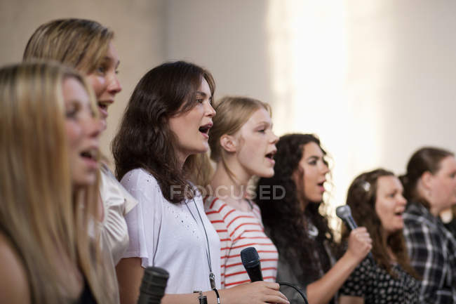 Female choirs singing at church — Stock Photo