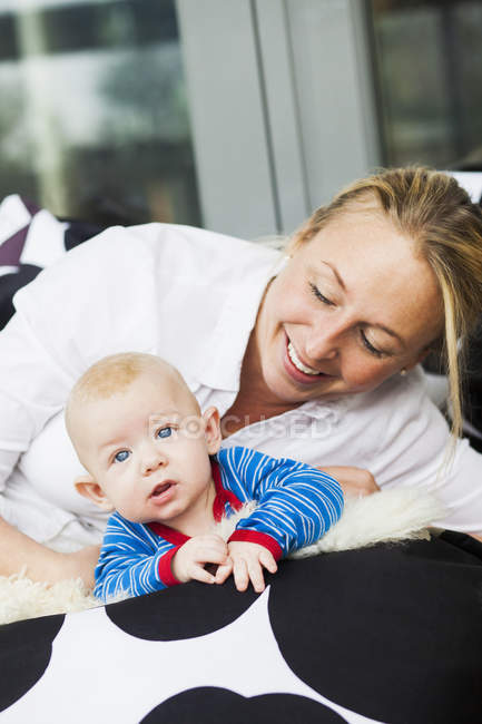 Happy mother looking at baby boy — Stock Photo