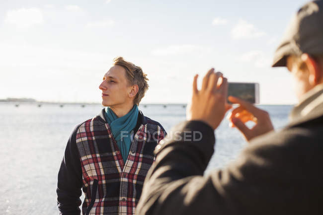 Man photographing gay partner — Stock Photo