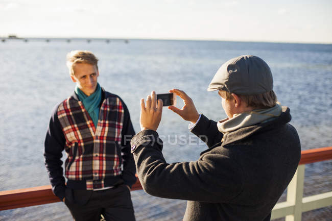 Man photographing gay partner — Stock Photo