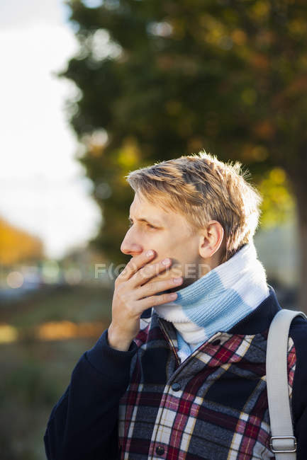 Thoughtful young gay man — Stock Photo