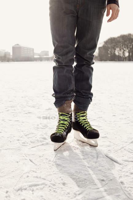 Man ice-skating on rink at park — Stock Photo