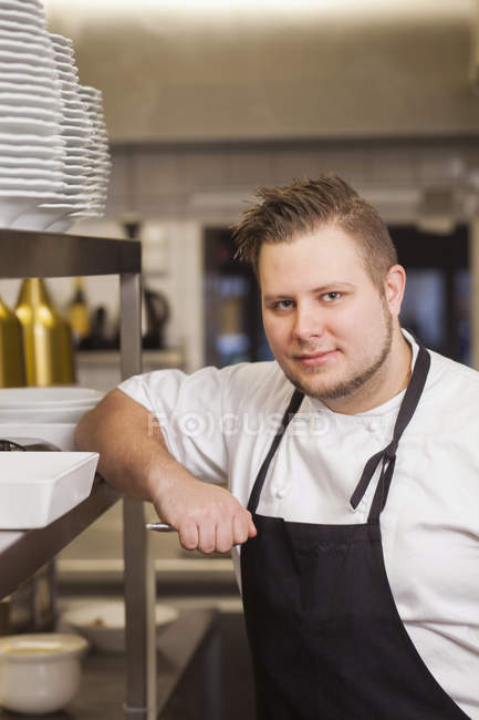 Confident chef standing at commercial kitchen — Stock Photo