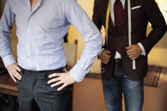 Fashion designer and male customer — Stock Photo