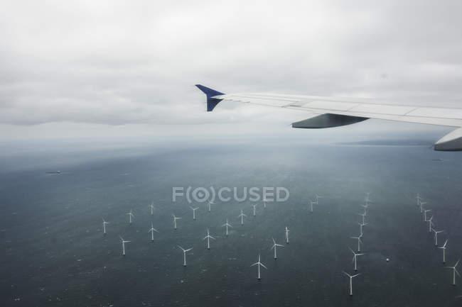Foggy field with wind turbines — Stock Photo
