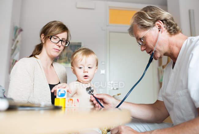 Baby with mother and doctor — Stock Photo