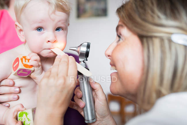 Baby being examined by doctor — Stock Photo