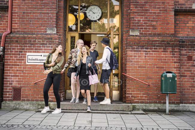 Students leaving school — Stock Photo