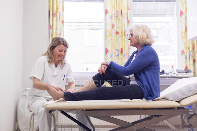 Senior woman with doctor — Stock Photo