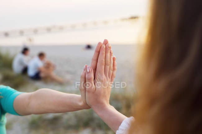 Woman and teenage girl touching hands — Stock Photo