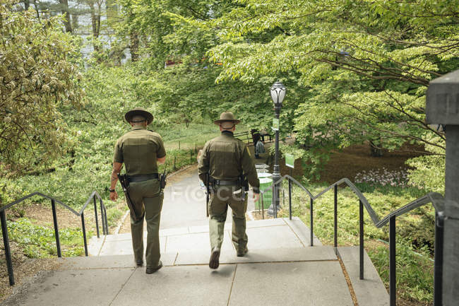 Security staff in public park — Stock Photo