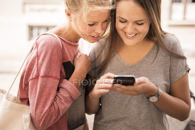 Women using mobile phone — Stock Photo