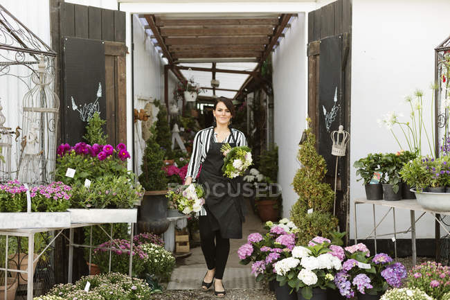 Florist walking with bouquets — Stock Photo
