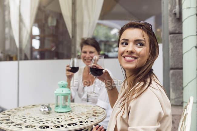 Women drinking red wine — Stock Photo