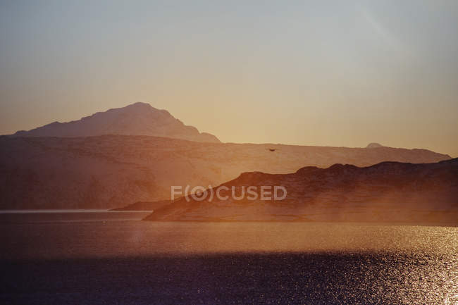 Sea coastline at sunset — Stock Photo