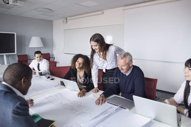 Team of architects working with blueprints — Stock Photo