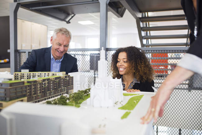 Architects looking at buildings model — Stock Photo