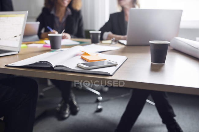 Smartphone, notebook and coffee on table — Stock Photo