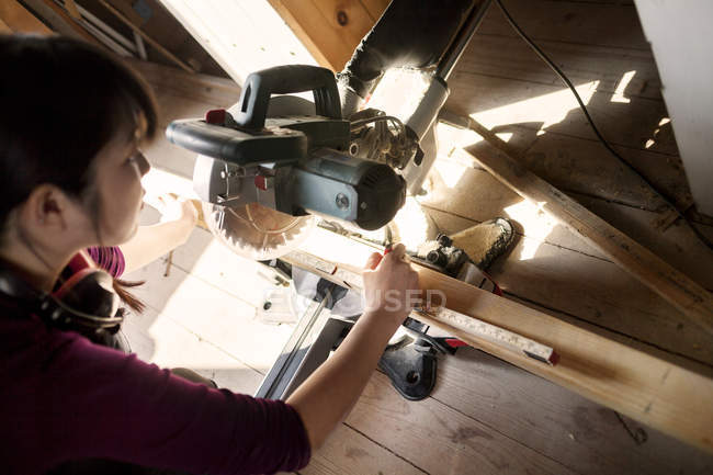 Woman working with wood — Stock Photo