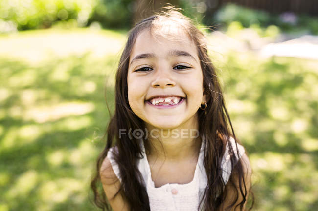 Little smiling brunette girl — Stock Photo