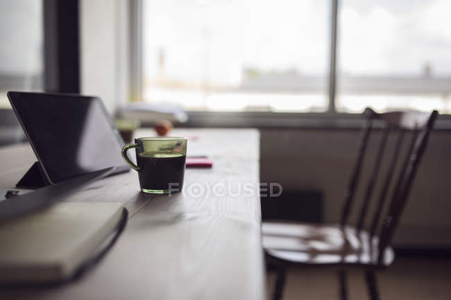 Coffee and digital tablet on table — Stock Photo