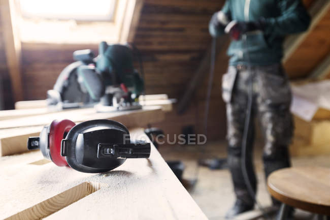Man plugging in power tool — Stock Photo