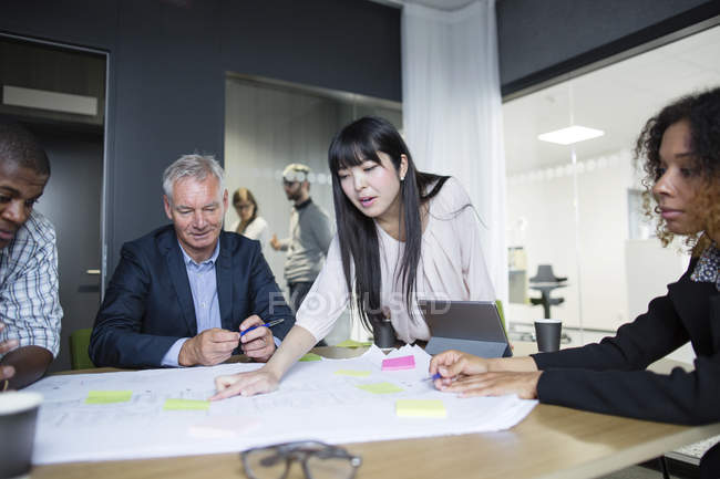 Architects discussing blueprint — Stock Photo