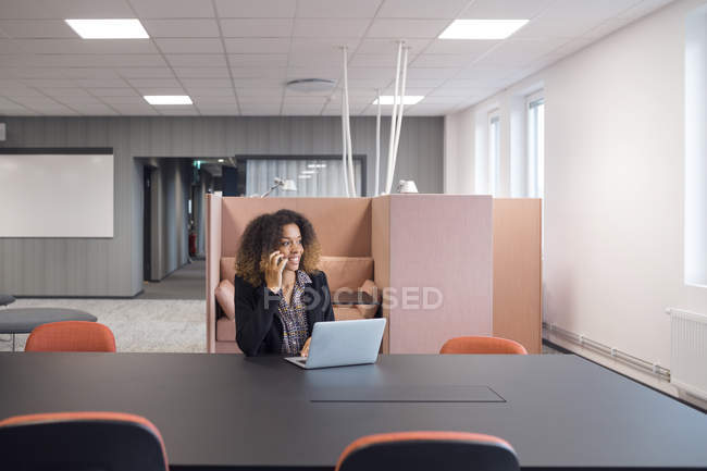 Woman working with laptop — Stock Photo