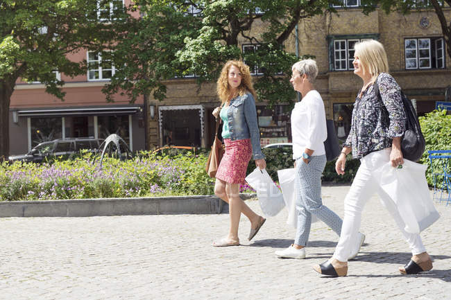 Women walking with shopping bags — Stock Photo