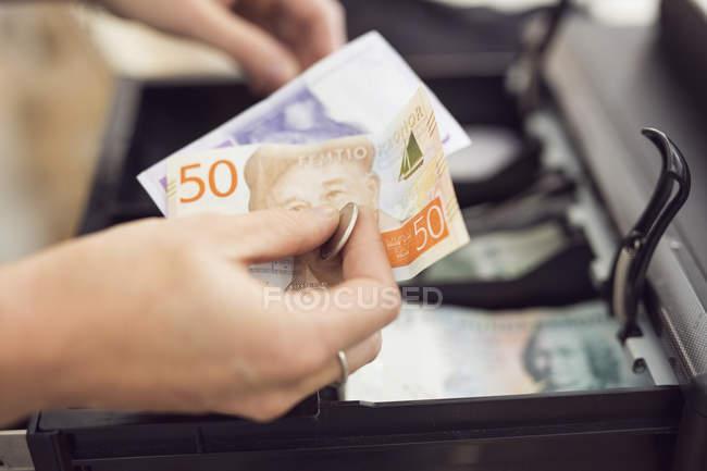 Female hands taking money — Stock Photo