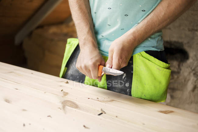 Male hands with knife — Stock Photo