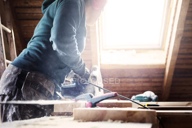 Woman using power tools — Stock Photo