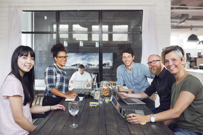 Coworkers looking in camera in office — Stock Photo