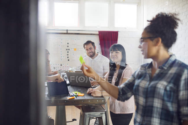 Coworkers brainstorming in office — Stock Photo