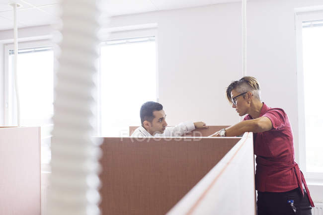 Colleagues talking in cubicles — Stock Photo