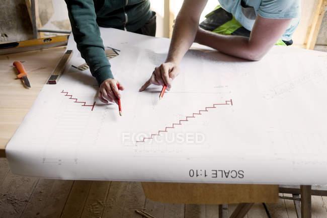 Couple working on renovating blueprint — Stock Photo