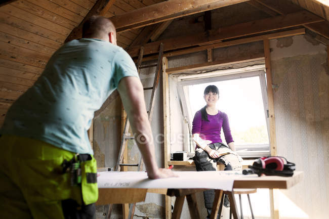 Couple talking at old attic — Stock Photo