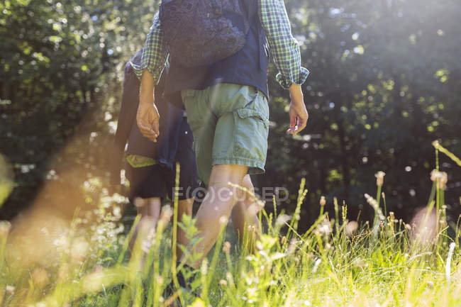 Man and woman walking in meadow — Stock Photo