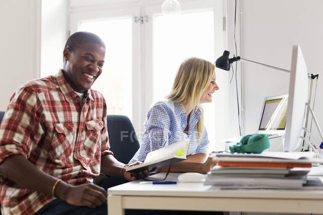 Editors working together and laughing — Stock Photo